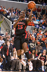 Georgia guard Jaleesa Rhoden (15) leaps to the basket in action against UVA.  The #15 ranked Virginia Cavaliers defeated the Georgia Lady Bulldogs 62-60 in NCAA Women's Basketball at the John Paul Jones Arena on the Grounds of the University of Virginia in Charlottesville, VA on January 2, 2009.