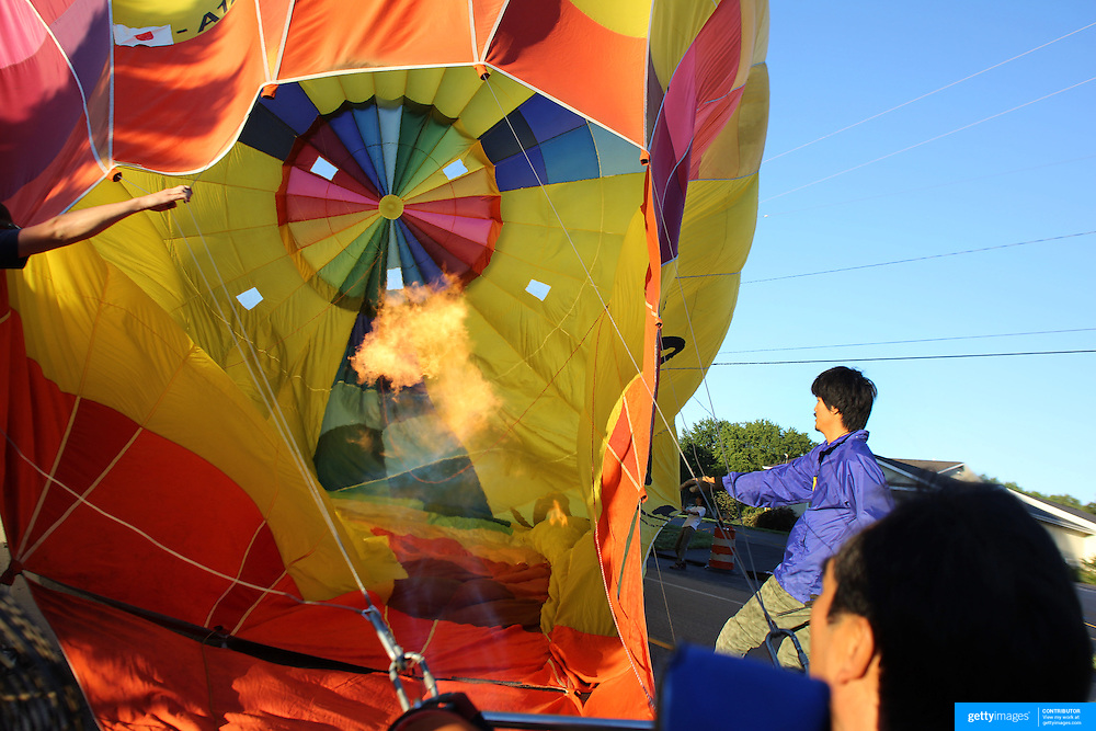Yudai Fujita, Japan, and his crew prepare to launch during a practice flight during the World Hot Air Ballooning Championships in Battle Creek, Michigan, USA. 17th August 2012. Photo Tim Clayton