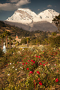 Huascaran, two summits, 6768 metres, highest peak in Cordillera Blanca, above city of Yungay memorial garden for 50,000 victims of 1970 avalanche, near Huaraz, Andes mountains, Peru
