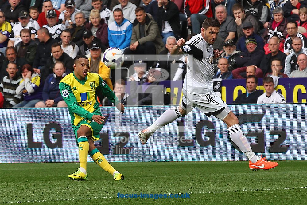 Martin Olssen of Norwich crosses the ball during the Barclays Premier League match at the Liberty Stadium, Swansea<br /> Picture by Paul Chesterton/Focus Images Ltd +44 7904 640267<br /> 29/03/2014