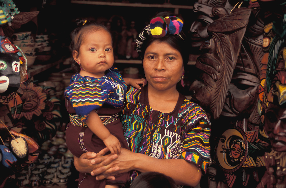 Woman with kid at Crafts Market, Antigua, Guatemala, Central America