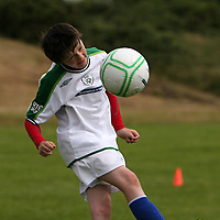 Johnny Williams gets a head to it at the FAI summer soccer camp in Gallery Park in Kilrush during the week.<br /> Photograph by Yvonne Vaughan