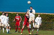 Essex's Noah Ferris (21) leaps to head the ball during the boys soccer game between the Champlain Valley Union Redhawks and the Essex Hornets at Essex High School on Saturday mooring October 10, 2015 in Essex. (BRIAN JENKINS/For the FREE PRESS)