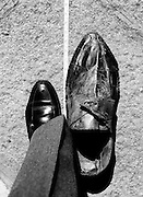 In 1985, Shaun Aisbitt from Ballybough in Dublin was declared to be the tallest man in Ireland. His shoes are reckoned to be size twenty-two. The shoes are on display in the Dublin Civic Museum in South William Street, Dublin, and one is shown here in comparison to a size eleven shoe.