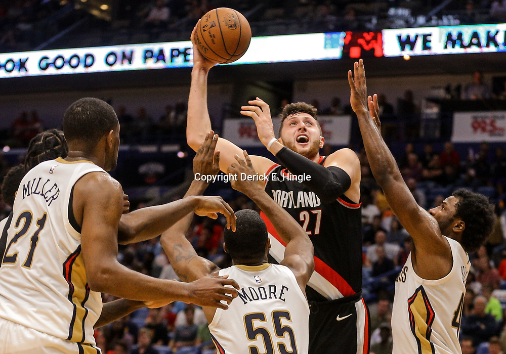 Mar 27, 2018; New Orleans, LA, USA; Portland Trail Blazers center Jusuf Nurkic (27) shoots as New Orleans Pelicans forward Solomon Hill (44) and forward E'Twaun Moore (55) defend during the second half at the Smoothie King Center. The Trail Blazers defeated the Pelicans 107-103. Mandatory Credit: Derick E. Hingle-USA TODAY Sports