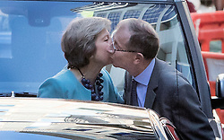 © Licensed to London News Pictures. 14/07/2016. London, UK. Prime Minister Theresa May kisses her husband Philip as she leaves her old apartment before heading to Downing Street for her first full day in office. Photo credit: Peter Macdiarmid/LNP