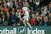 Milton Keynes Dons defender Russell Martin (16) heads the ball towards Milton Keynes Dons forward Jordan Bowery (9) (not in picture) during the EFL Cup match between Milton Keynes Dons and Liverpool at stadium:mk, Milton Keynes, England on 25 September 2019.