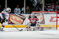 KELOWNA, CANADA - MARCH 28: Eric Comrie #1 of the Tri-City Americans makes a save against the Kelowna Rockets during game 5 of the first round of WHL playoffs on March 28, 2014 at Prospera Place in Kelowna, British Columbia, Canada.   (Photo by Marissa Baecker/Shoot the Breeze)  *** Local Caption *** Eric Comrie;