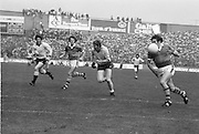 Kerry catches the ball as player close in on him during the All Ireland Senior Gaelic Football Final Dublin v Kerry in Croke Park on the 26th September 1976. Dublin 3-08 Kerry 0-10.