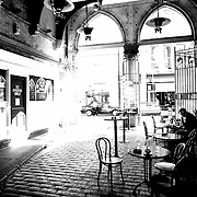 A man reading a book on a cafe in Dublin city centre.