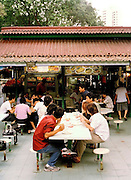 Full table of diners at Newton Circus Hawker center