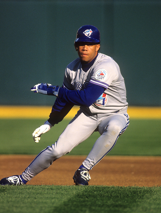 OAKLAND - 1991:  Roberto Alomar of the Toronto Blue Jays runs the bases against the Oakland Athletics during a 1991 MLB game at the Oakland Coliseum.  Alomar played for the Blue Jays from 1991-1995.  (Photo by Ron Vesely)