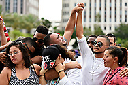 Thousands of people attend a vigil in the wake of the Orlando shooting, held in downtown Orlando at Dr. Phillips Center for the Performing Arts. Friends of Amanda Alvear and Mercedes Flores embrace, cry and show their support for friends lost in the Pulse Nightclub shooting. A gunmen opened fire in a gay nightclub in Orlando, Fla. early Sunday morning killing 49 people and wounding 53 more. It's being called the worst mass shooting in U.S. history.