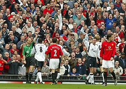 MANCHESTER, ENGLAND - Saturday, April 5, 2003: Liverpool's Sami Hyypia is showen the red card against Manchester United during the Premiership match at Old Trafford. (Pic by David Rawcliffe/Propaganda)