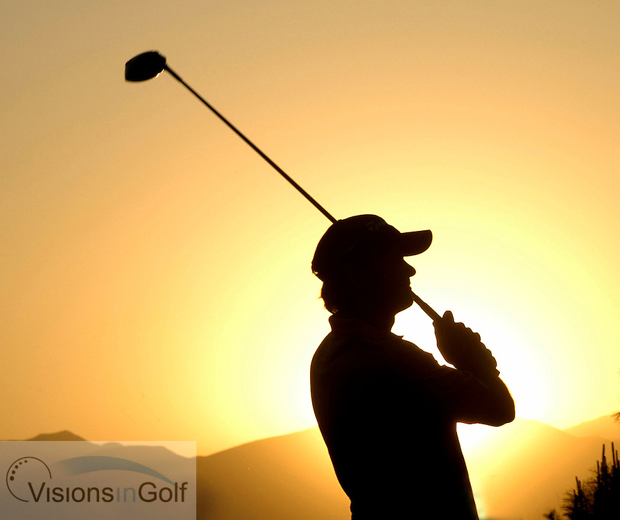 22 April 2005. Johnnie Walker Classic, Pine Valley Golf Club, Beijing, China. Retief Goosen tees off on the par-four 18th during round 2 as the sun sets over the mountains.<br />