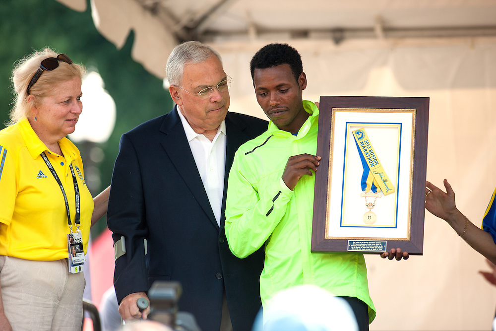 Lilesa Desisa presents Mayor Menino with his winner's medal from Boston Marathon