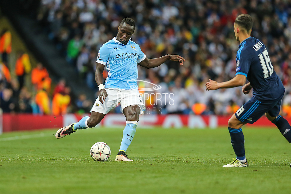 Manchester City's Bacary Sagna crosses the ball during the Champions League match between Manchester City and Real Madrid at the Etihad Stadium, Manchester, England on 26 April 2016. Photo by Shane Healey.