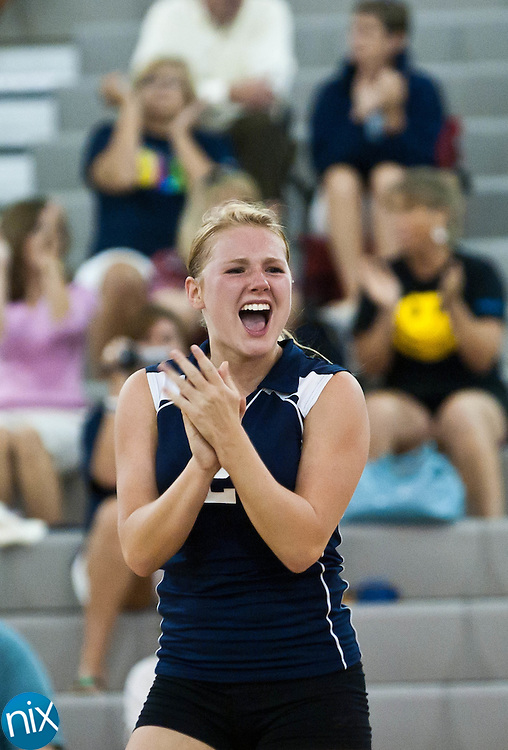 Hickory Ridge's Jesslyn Ferentz celebrates a point against Cox Mill Tuesday night at Cox Mill High School. Hickory Ridge won the match.  (Photo by James Nix)