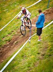 12.06.2011, Bikepark, Leogang, AUT, UCI MOUNTAINBIKE WORLDCUP, LEOGANG, im Bild Feature Downhill Mountainbike, Mitzieher, ein zuschauer schaut den Biker zu // during the UCI MOUNTAINBIKE WORLDCUP, LEOGANG, AUSTRIA, 2011-06-12, EXPA Pictures © 2011, PhotoCredit: EXPA/ J. Feichter