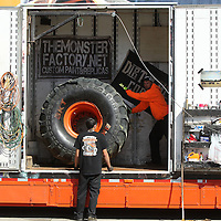 Adam Robison | BUY AT PHOTOS.DJOURNAL.COM<br /> Kevin King, owner and driver of the Monster Jam truck Fluffy, pulls one of the 66 inch tall and 43 inch wide tires from its storage spot on the travel trailer as he and crew worker Brandon Thong, prepare the Monster Jam truck once arriving at the BancorpSouth Arena on Thursday morning.