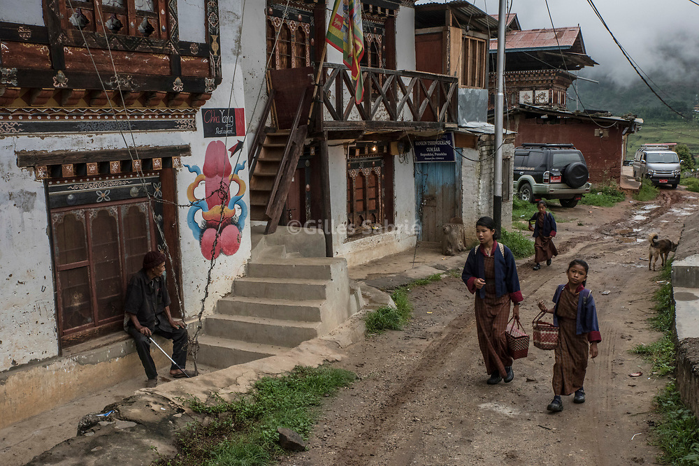 For a story by Steven Lee Myers, Bhutan<br /> Lobesa, Bhutan, August 2nd, 2017<br /> Girls on their way to school passing by a village house on which a phallus has been painted. Locals believe that the phallic symbols bring good luck and drives away evil spirits, Its origin can be found in the Bon religion that predated the advent of Tibetan Buddhism. Phallus representations are also linked to the XVIth century Lama Drukpa Kunley  popularly known as the &ldquo;Divine Madman&rdquo; for his unorthodox ways of teaching, and for his bizarre and shocking behaviours.<br /> Gilles Sabri&eacute; pour The New York Times