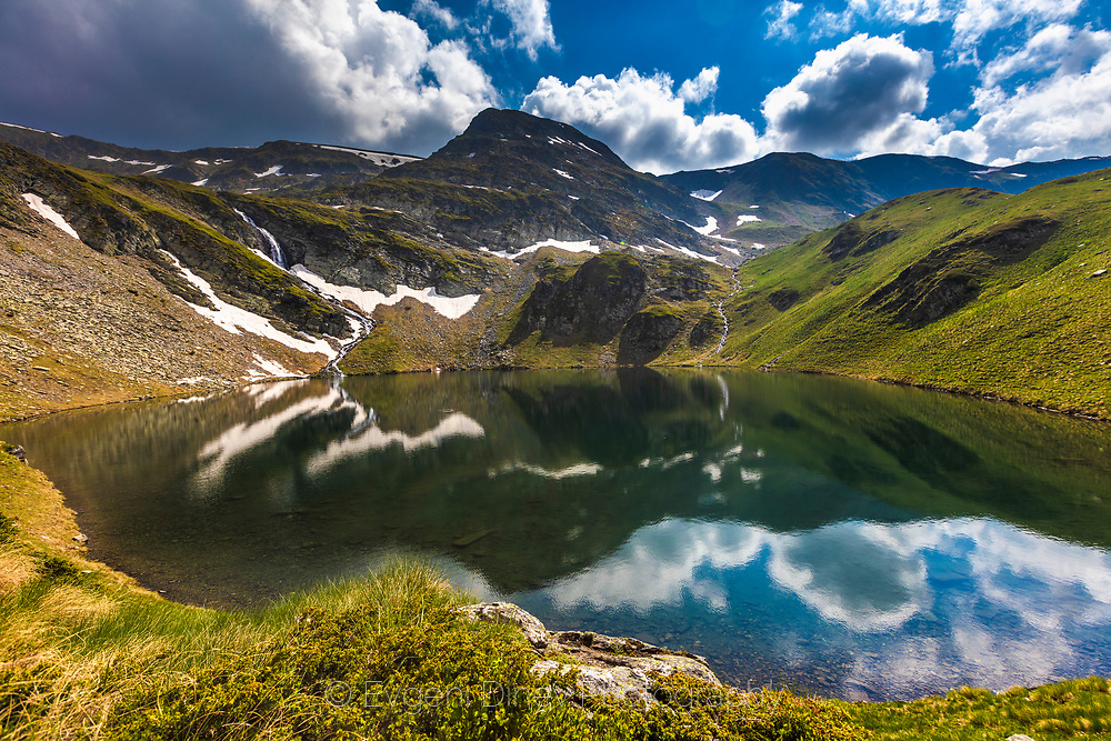 Reflections of a mountain in a crystal lake