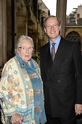 "Royal, Religious and National Events Commentator for Sky News ALASTAIR BRUCE and his mother MRS HENRY BRUCE at a private view to view ""The Coronation Theatre: Portrait of Her Majesty Queen Elizabeth II"" painted by Ralph Heimans held at Westminster Abbey, London on 12th September 2013."