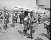"Bob Hope, flying in to attend a showing of his film ""8 n the Run"" at the Savoy Cinema, baffled the reception party there to meet him when he marched down between the rows of girls of the Emerald Girls Pipe Band and took over the mace from Drum Major Miss Marie Doran..18.05.1968"