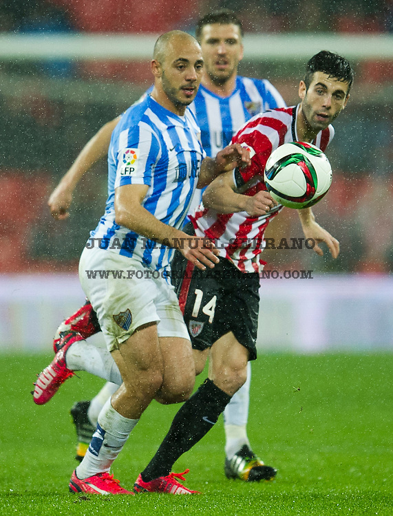 BILBAO, SPAIN - JANUARY 29:  Markel Susaeta of Athletic Club duels for the ball with Nordin Amrabat of Malaga CF during the Copa del Rey Quarter Final Second Leg match between Athletic Club and Malaga CF at San Mames Stadium on January 29, 2015 in Bilbao, Spain.  (Photo by Juan Manuel Serrano Arce/Getty Images)