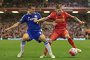 Alberto Moreno (Liverpool) holds off the Chelsea defender during the Barclays Premier League match between Liverpool and Chelsea at Anfield, Liverpool, England on 11 May 2016. Photo by Mark P Doherty.