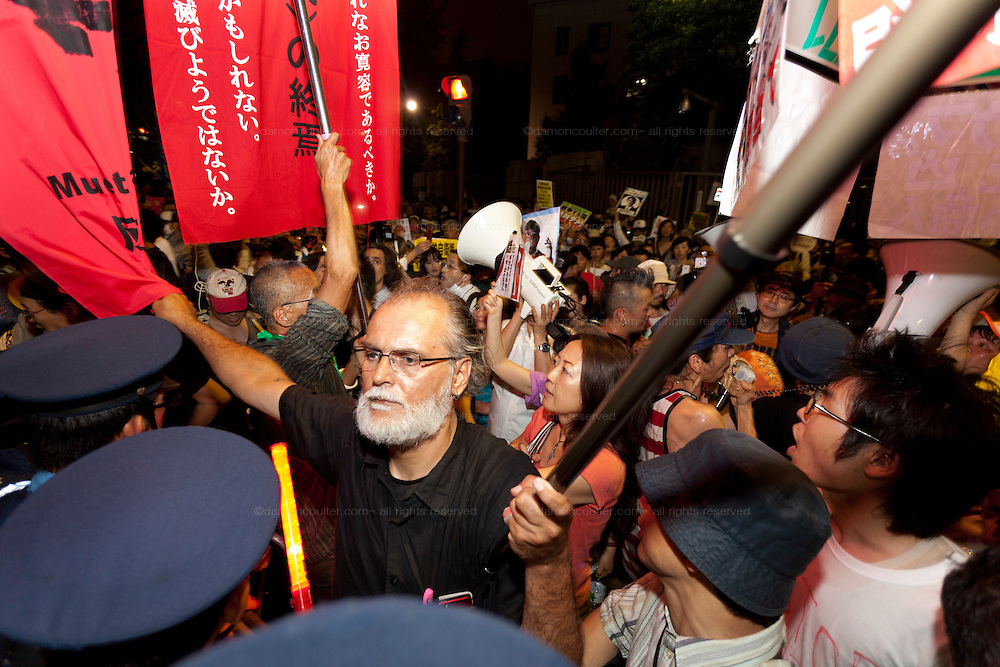 Bosnian peace activist, Sulejman Brkic at a protest against the revision of article 9 of the Japanese Constitution outside the Prime-Minister's house in Kasumigasaki, Tokyo, Japan. Monday June 30th 2014. Over 10,000 people showed their support for Japan's unique peace constitution and called on the government to halt its reinterpretation of Article 9 allowing Collect Self Defence which is expected to become law on July 1st
