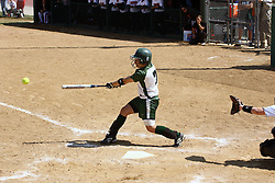 05 April 2008: Monica Urban puts the ball in play. The Carthage College Lady Reds lost the first game of this double header to the Titans of Illinois Wesleyan 4-1 at Illinois Wesleyan in Bloomington, IL