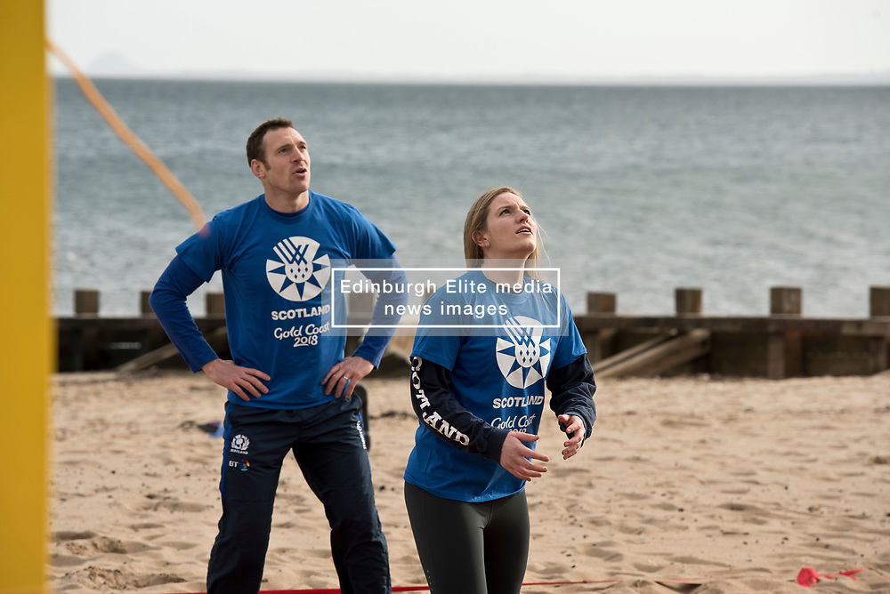 Today marks one year to go before the next Commonwealth Games get underway in Gold Coast, Australia. Athletes from a number of sports joined Scottish Beach Volleyball players, including top duo Lynne Beattie and Mel Coutts, on the new permanent courts on Portobello Beach this morning. The athletes joined with children from Towerbank Primary School to try out the game in the Portobello sunshine.   Pictured: Scott Riddell and Sarah Thomson<br /> <br /> <br /> © Jon Davey/ EEm