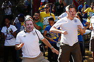 Two England fans wearing Harry Redknapp and David Beckham masks sing &quot;football's going home&quot; with a Brazilian percussion band outside the stadium before the 2014 FIFA World Cup match at Mineirao, Belo Horizonte, Brazil. <br /> Picture by Andrew Tobin/Focus Images Ltd +44 7710 761829<br /> 24/06/2014