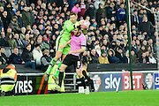 MK Dons goal keeper David Martin under pressure from Northampton Town defender Zander Diamond  during the The FA Cup Third Round Replay match between Milton Keynes Dons and Northampton Town at stadium:mk, Milton Keynes, England on 19 January 2016. Photo by Dennis Goodwin.