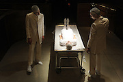 Models perform in a staged surgical theater at the Thom Browne Fall 2015 show during New York Fashion Week, Monday, Feb. 16, 2015.  (AP Photo/Diane Bondareff)