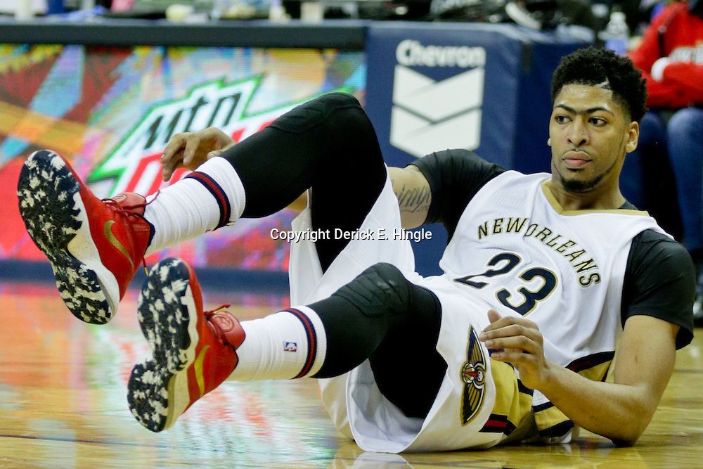 Jan 6, 2016; New Orleans, LA, USA; New Orleans Pelicans forward Anthony Davis (23) is knocked to the floor during the second half of a game against the Dallas Mavericks at the Smoothie King Center. The Mavericks defeated the Pelicans 100-91. Mandatory Credit: Derick E. Hingle-USA TODAY Sports