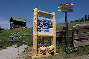 Rural village information with hiking routes signpost near La Val in Alta Badia, south Tyrol, Italy.