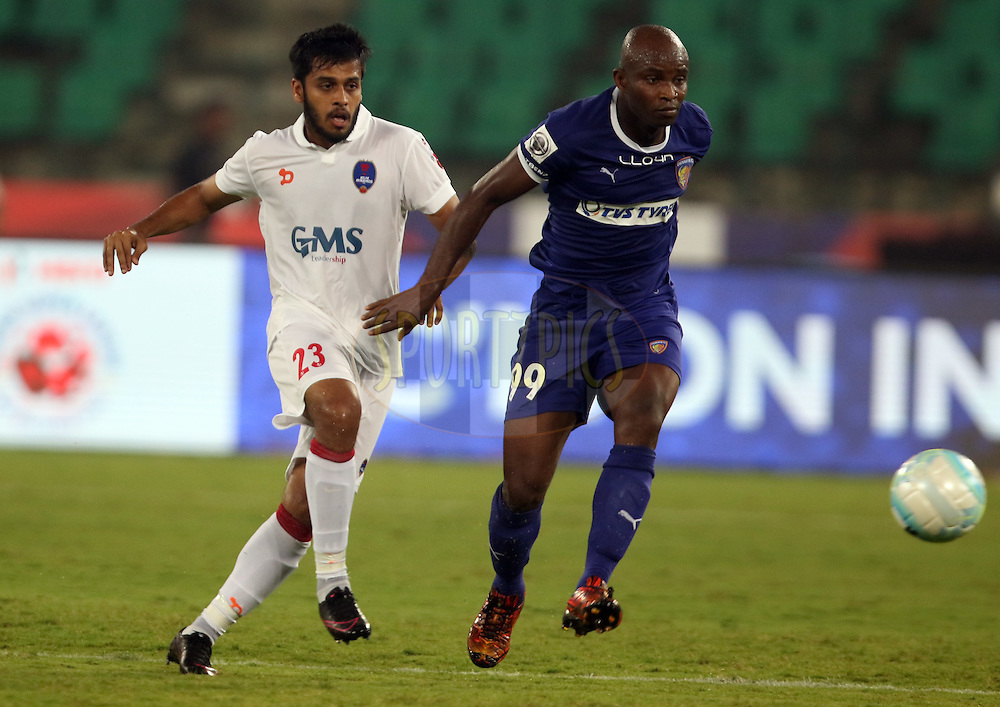 delhi dynamos player souvik chakrabarti tackles with chennaiyin fc player during match 6 of the Indian Super League (ISL) season 3 between Chennaiyin FC and Delhi Dynamos FC held at the Jawaharlal Nehru Stadium in Chennai, India on the 6th October 2016.<br /> <br /> Photo by Rahul Goyal / ISL/ SPORTZPICS