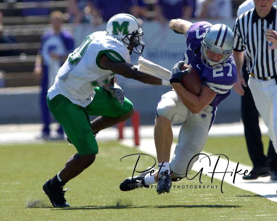 Marshall linebacker Dennis Thornton (L) pushes Kansas State wide receiver Jordy Nelson (R) out of bounds in the second half, at Bill Snyder Family Stadium in Manhattan, Kansas, September 16, 2006.  The Wildcats beat the Thundering Herd 23-7.