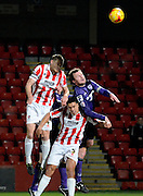Cheltenham captain Matt Taylor and Morecambe captain Mark Hughes challenge for a header during the Sky Bet League 2 match between Cheltenham Town and Morecambe at Whaddon Road, Cheltenham, England on 16 January 2015. Photo by Alan Franklin.