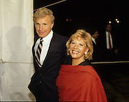 Wayne Rogers and Dinah Shore arrive at the 20th Century Fox dinnerduring Queen Elizabeth II visit to California in March 1983...Photograph by Dennis Brack b23