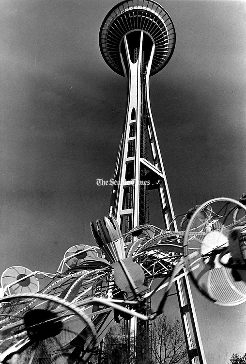 Sun washed the Space Needle and a popular Seattle Center ride as the Fun Forest swung into spring. (Larry Dion, The Seattle Times, 1975)