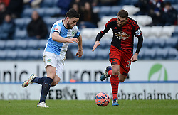 Blackburn Rovers's Craig Conway competes with Swansea City's Angel Rangel - Photo mandatory by-line: Richard Martin Roberts/JMP - Mobile: 07966 386802 - 24/01/2015 - SPORT - Football - Blackburn - Ewood Park - Blackburn Rovers v Swansea City - FA Cup Fourth Round