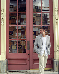 man standing in front of a store in Charleston, SC
