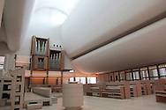 The Bagsv&aelig;rd Church by J&oslash;rn Utzon was completed in 1976. Though not his most famous work, the church is an example of the architect&rsquo;s inventive work at a different scale. Utzon designed the church with an unassuming exterior that merely hints at the stirring forms he created inside.<br />