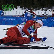 Winter Olympics, Vancouver, 2010.Ann Kristin Aafedt Flatland, Norway, feels the pain after finishing during the Women's 7.5 KM Sprint Biathlon at The Whistler Olympic Park, Whistler, during the Vancouver  Winter Olympics. 13th February 2010. Photo Tim Clayton