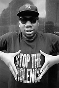US rapper KRS 1 of Boogie Down Productions wearing Stop the Violence t-shirt, UK, 1990's