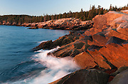 The colorful granite rocks of Otter Cliffs in Acadia National Park are a popular location for photographers and tourists alike.