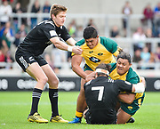 Australia prop Faalalie Sione is brought to ground by New Zealand flanker Mitchell Jacobson during the World Rugby U20 Championship 5rd Place play-off  match Australia U20 -V- New Zealand U20 at The AJ Bell Stadium, Salford, Greater Manchester, England on Saturday, June  25  2016.(Steve Flynn/Image of Sport)